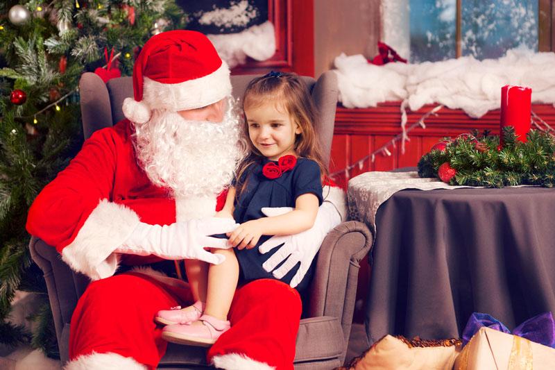 Girl sitting on Santa