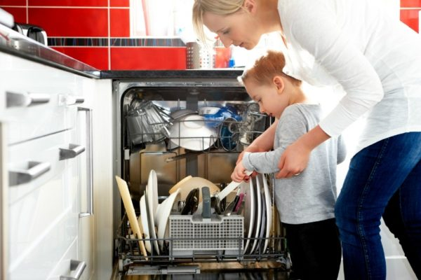 child helping with dishwasher