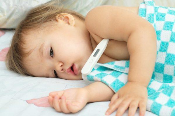 child ill taking temperature