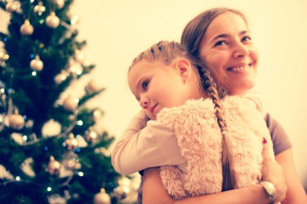 mum daughter christmas hug