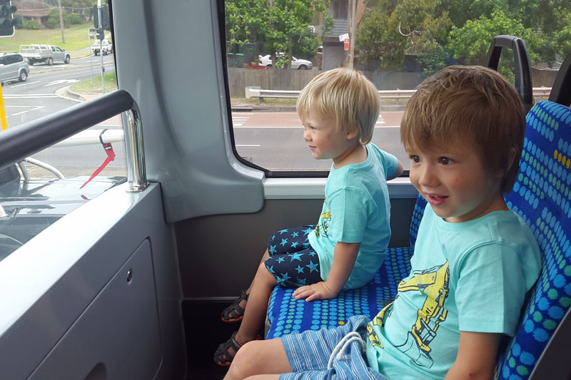 Leon and Sam on a double decker bus
