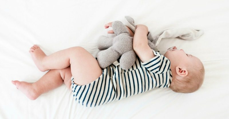 baby sleeping with soft toy