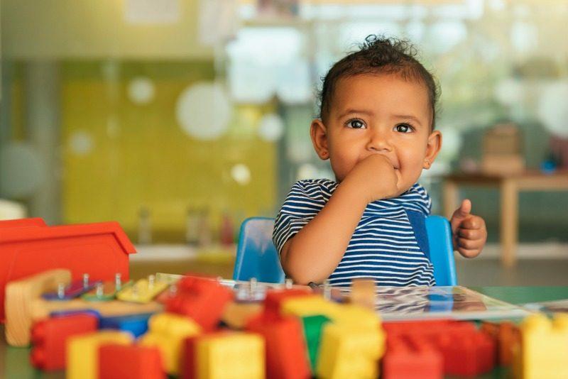 Toddler boy playing with blocks