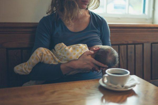 Breastfeeding woman in cafe
