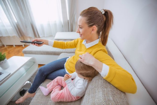 Mother watching TV with daughter