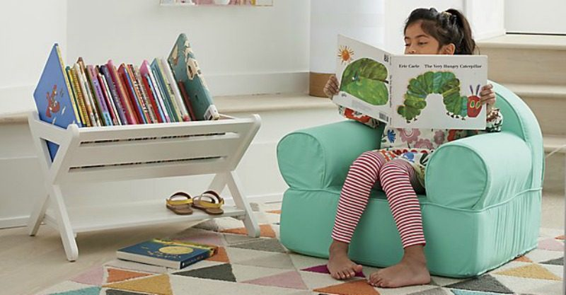 Girl reading next to book caddy