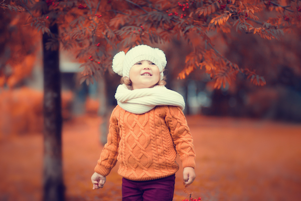 Adorable toddler girl portrait on beautiful autumn day.