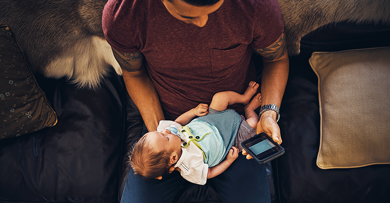 New dad on phone