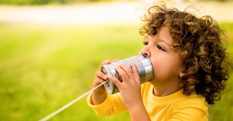 Toddler with tin string phone