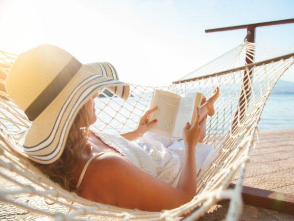 Woman in a hammock reading