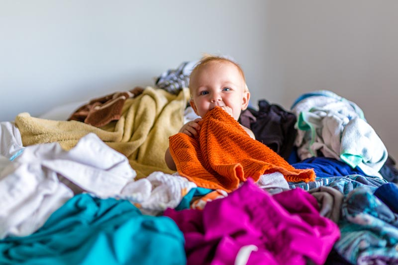 Baby in washing pile