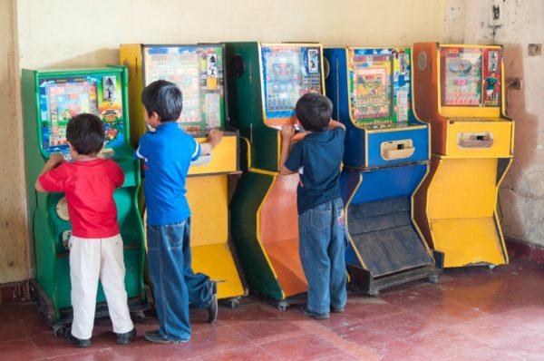 children playing arcade games