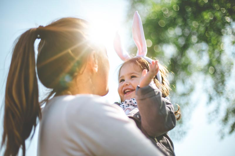 Mother and her daughter wearing bunny ears