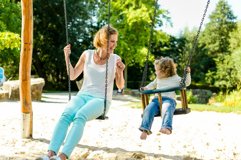 Mum and daughter on swing