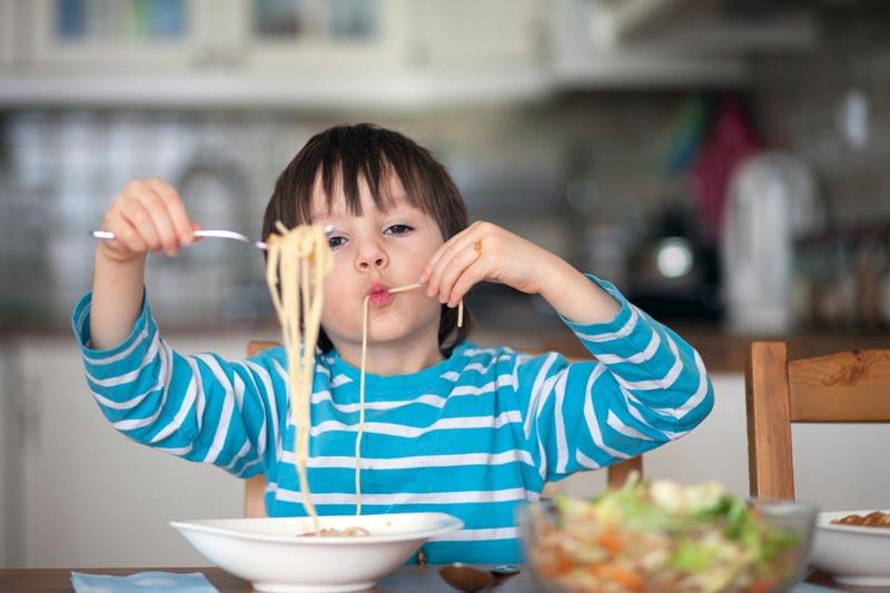 Boy eating spag bol