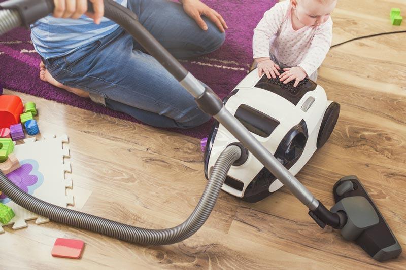 Baby on vacuum cleaner