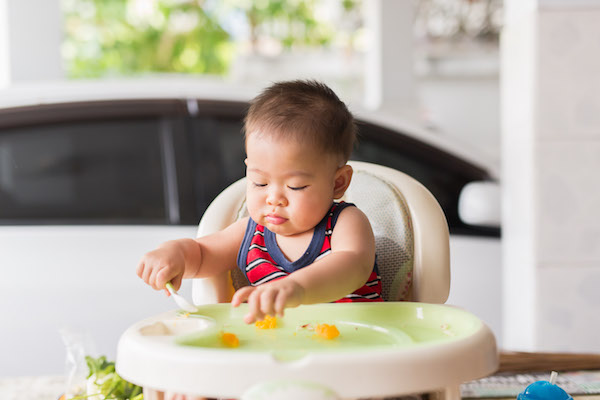 Baby eating in high chair