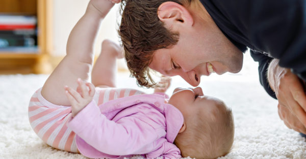 Happy proud young father with newborn baby daughter, family port