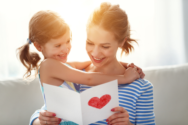 Mum and daughter with heart card