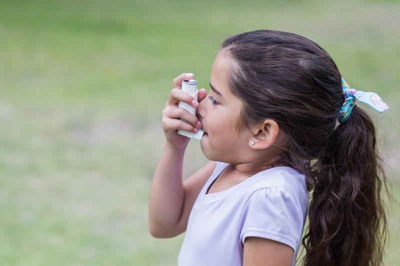 Girl holding ventalin puffer