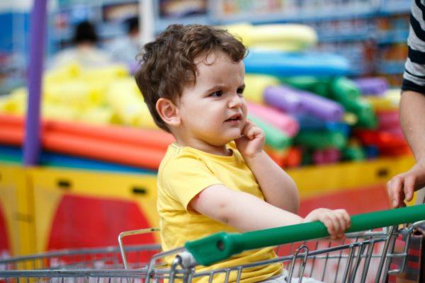 boy in supermarket trolley