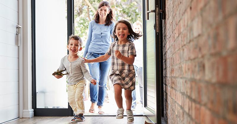 Kids and mum running into home