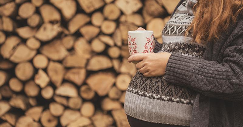 Pregnant woman drinking tea or coffee