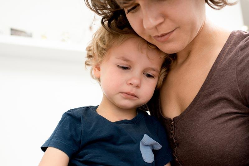 Sad toddler with mum