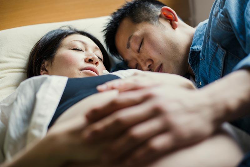 Pregnant sleeping couple