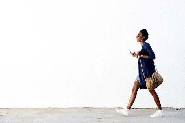 woman / mum walking with phone