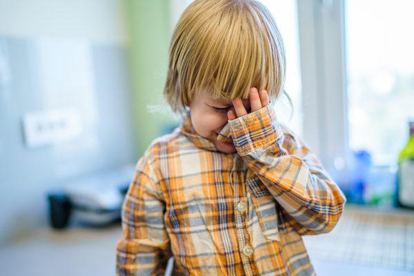Toddler boy crying sad