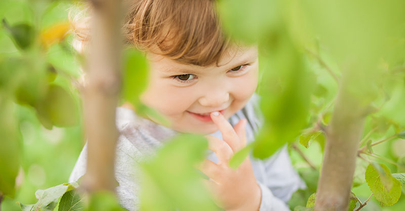 Toddler in garden outside