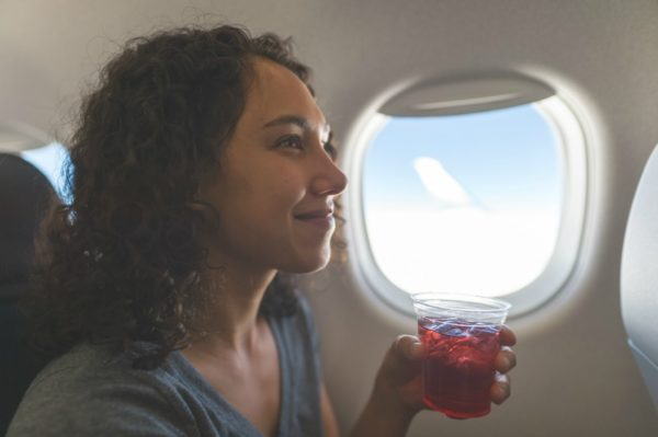 woman relaxing on plane