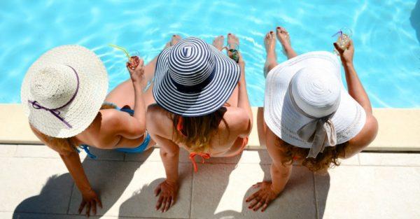 women relaxing pool