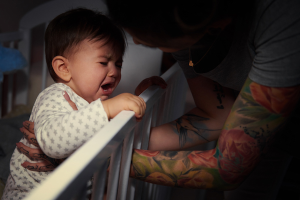 Child in cot crying