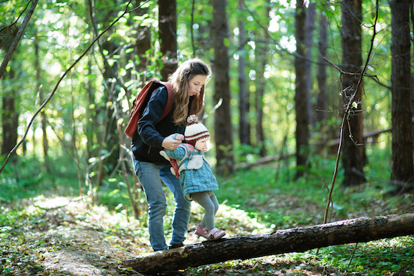 Woman and child in forest
