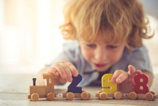 boy playing train