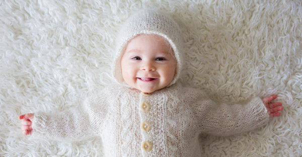 Cute teething and smiling baby