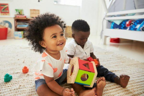 toddler girl boy playing