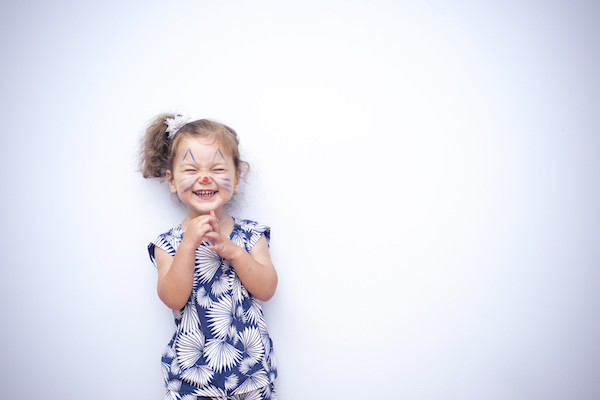 Preschool aged girl with face painted