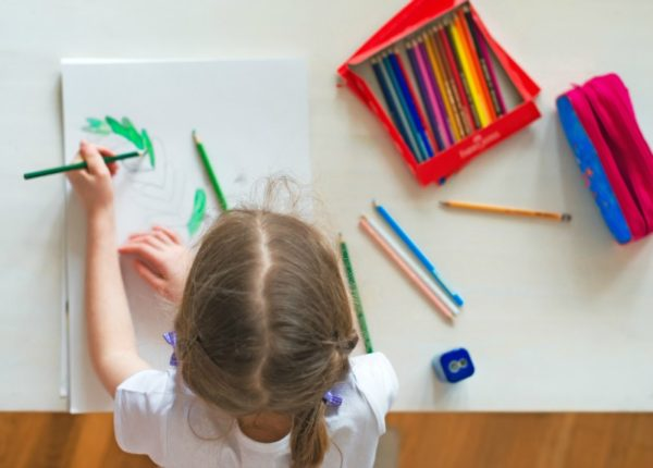 Girl drawing with left hand
