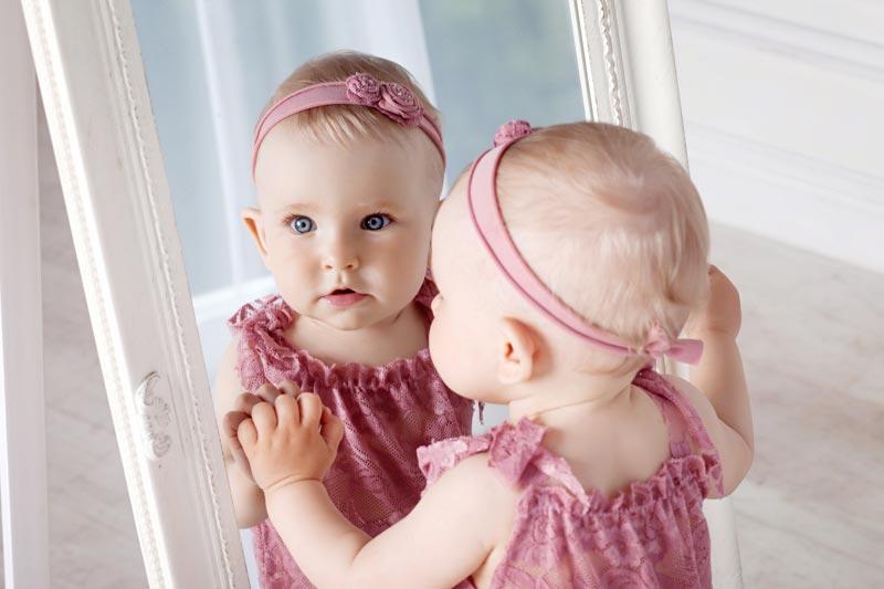 Baby looking in mirror