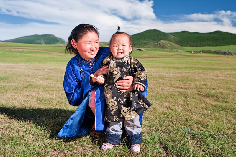Mongolian mother and baby in countryside