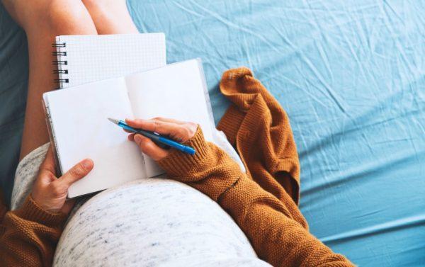 pregnant woman writing