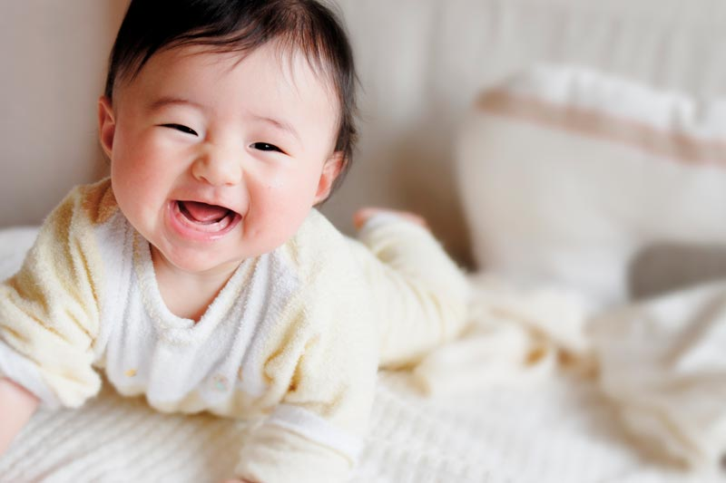 Japanese baby on bed