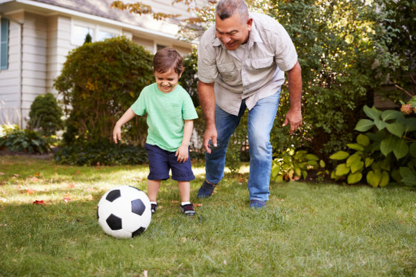 grandfather playing soccer grandson