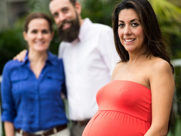 pregnant woman with couple