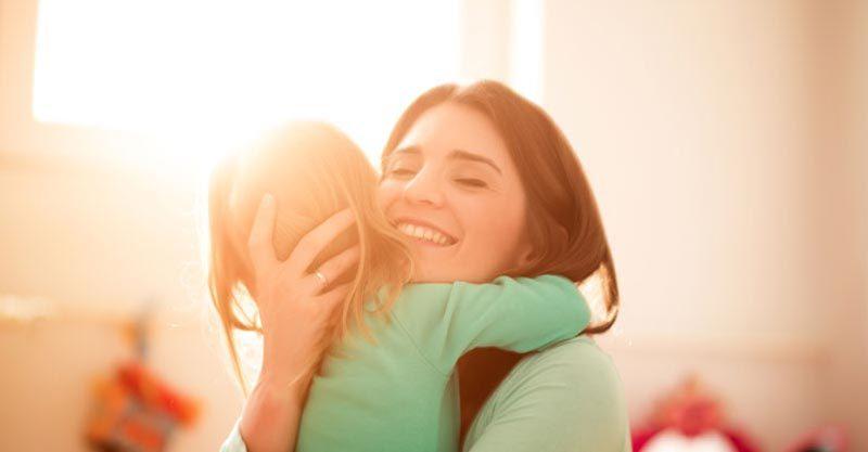 Teacher hugging child