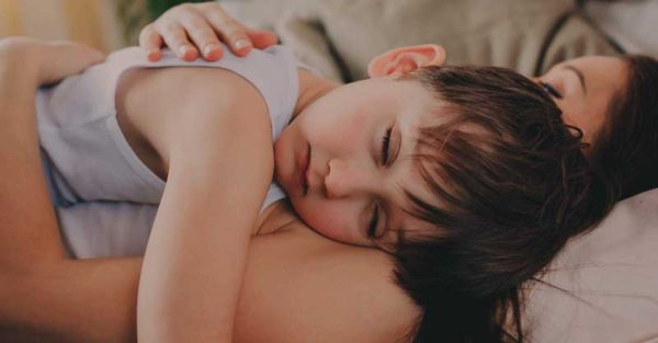 mother sleeping with son