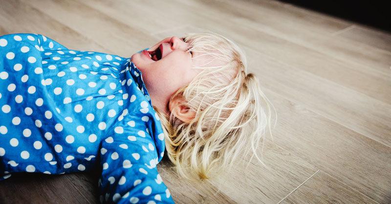 Toddler tantrum lying on floor